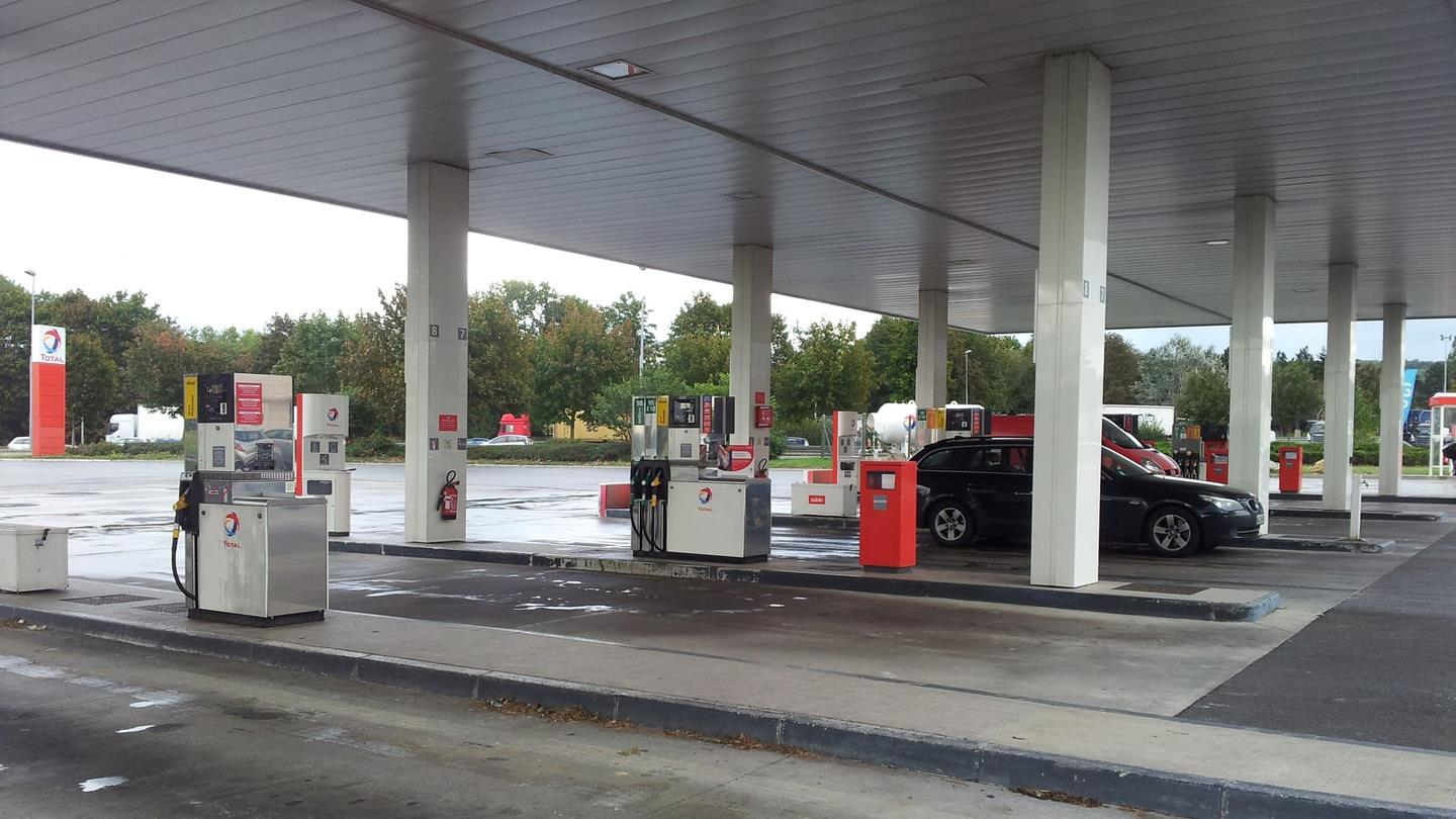 Car next to petrol pump at French petrol station Total