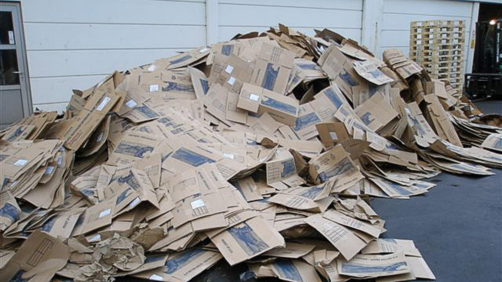 Heap of cardboard waste outside on the ground