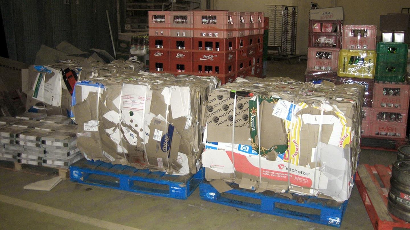 Cardboard bales and bottle crates in basement of Hilton Hotel