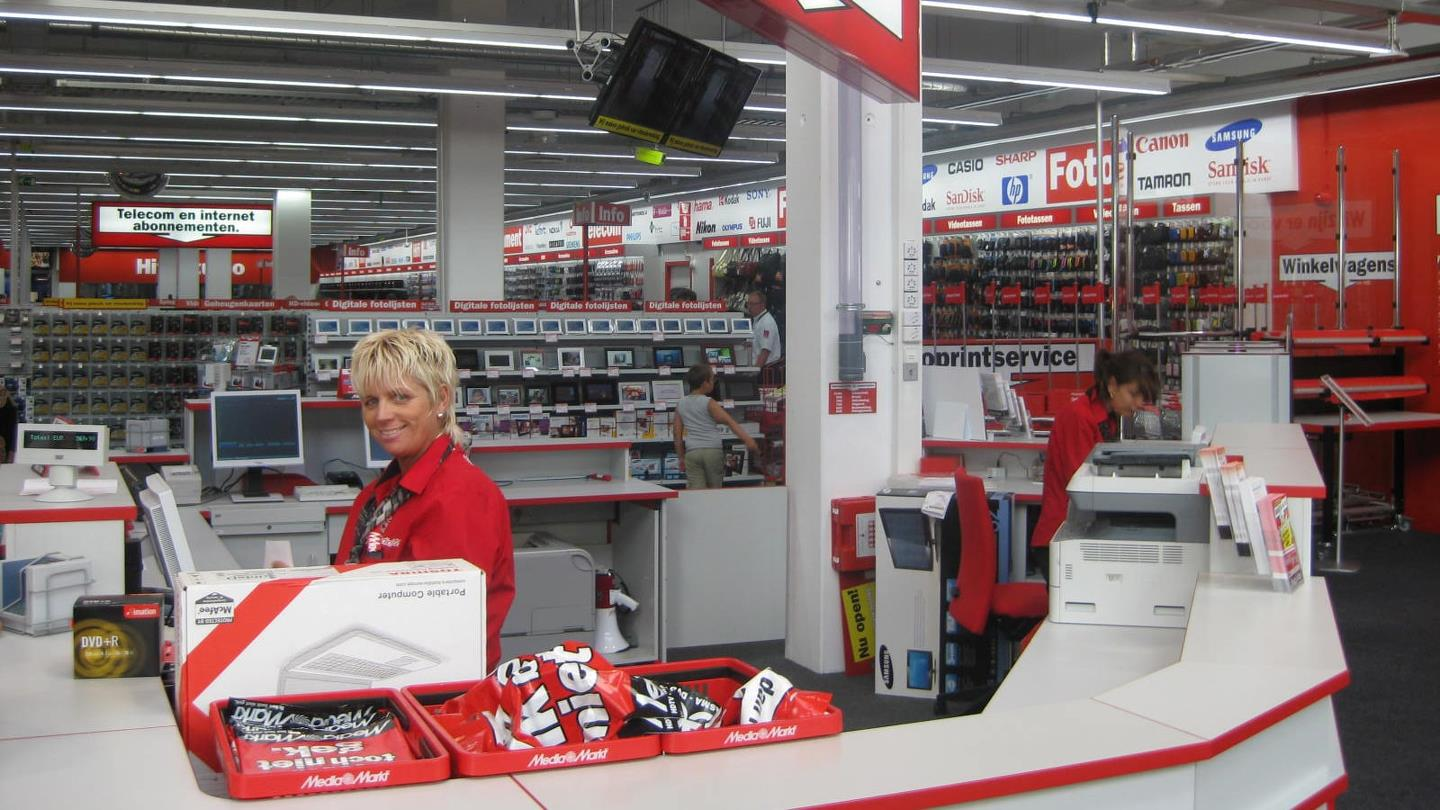 Two employees ready to help customers at Media Markt store