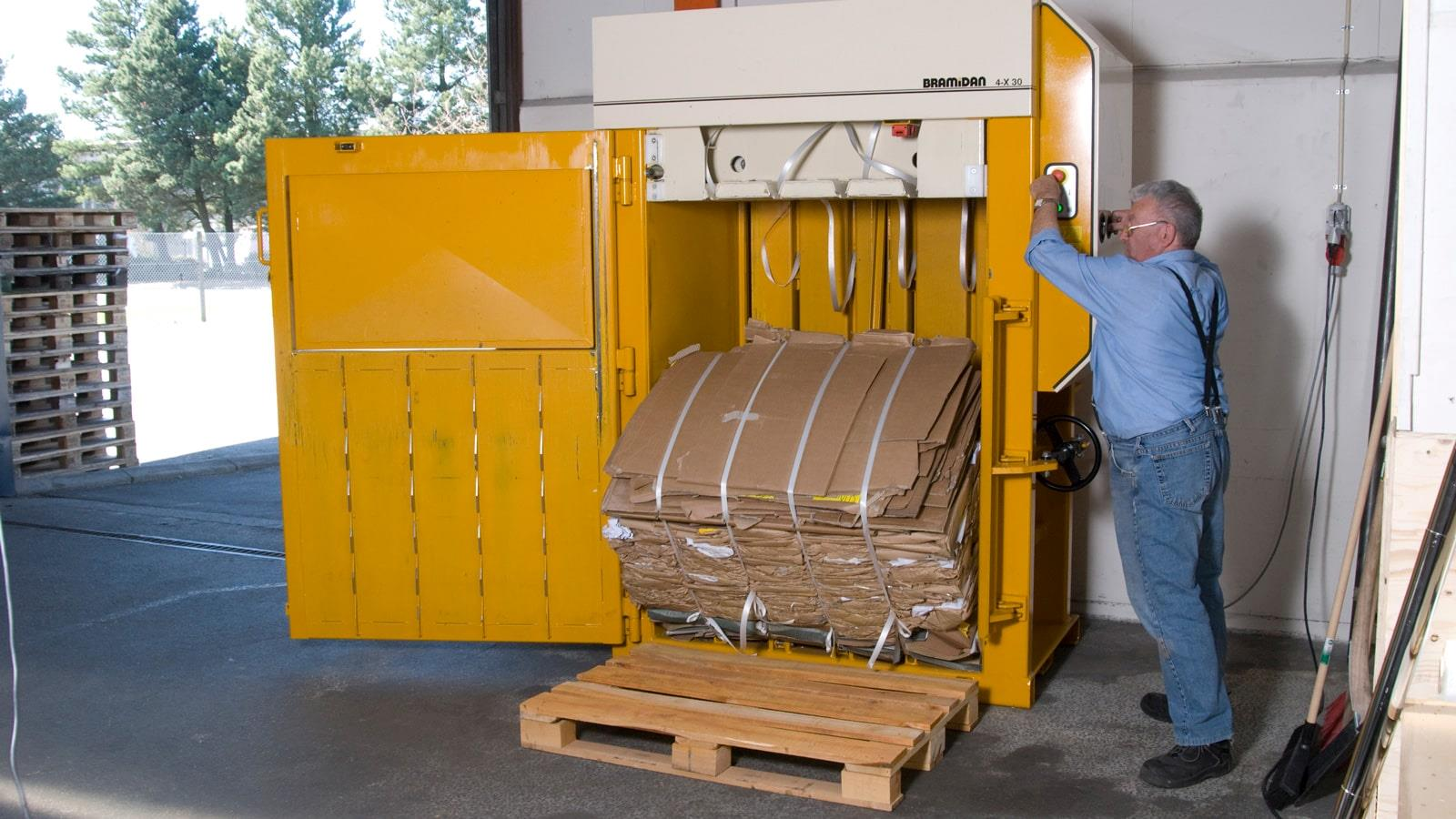 RewAir employee ejects cardboard bale out of Bramidan baler