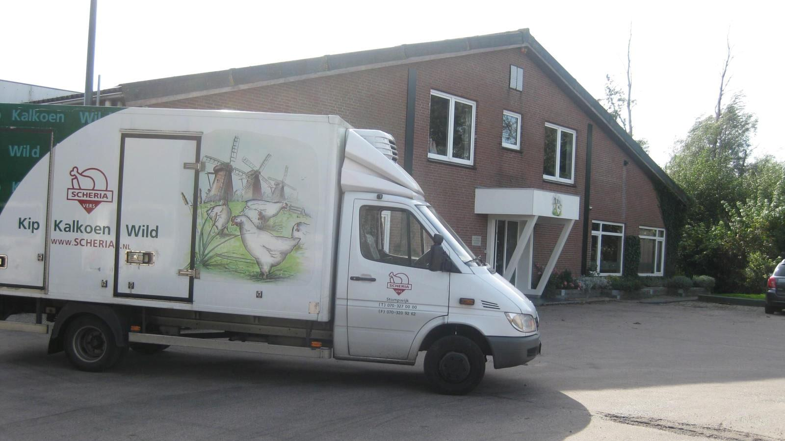 Van with chicken graphics standing outside Dutch company Scheria Versdienst