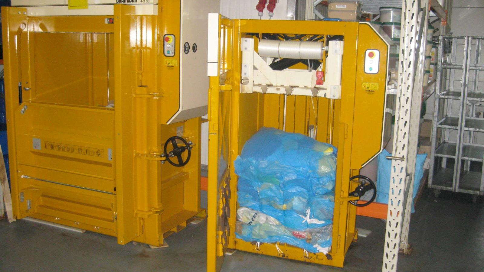 Bramidan baler with finished bale of blue plastic foil